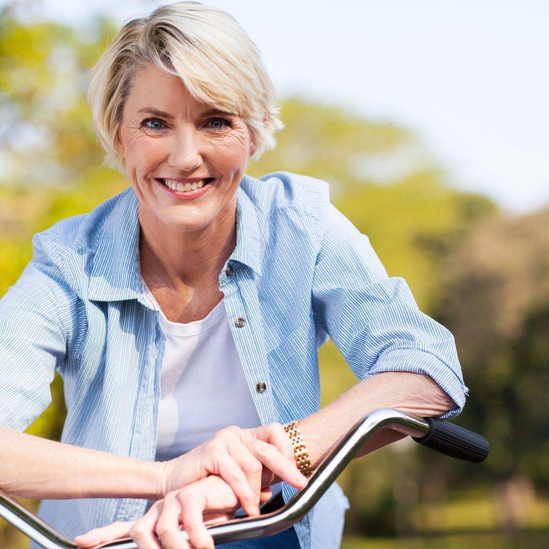 21512969 - close up portrait of senior woman on a bicycle